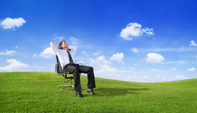 Businessman Relaxing on the Field Stock Photo