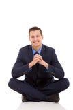 Businessman relaxing floor stock images