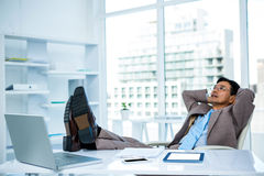 Businessman relaxing with his feet on his desk Royalty Free Stock Photography