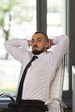 Businessman Relaxing With His Hands Behind His Head Royalty Free Stock Photography