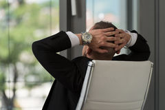 Businessman Relaxing With His Hands Behind His Head Royalty Free Stock Images