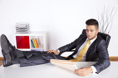 Businessman relaxing at his office stock photos