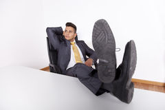 Businessman relaxing at his office Royalty Free Stock Image