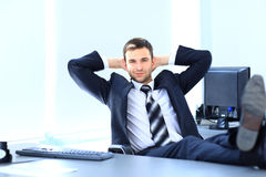 Businessman relaxing in his office Royalty Free Stock Image