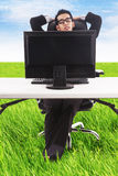 Businessman relaxing at his outdoor office Stock Photography