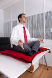 Businessman relaxing at the office royalty free stock images