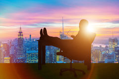 The businessman relaxing in the office Royalty Free Stock Images