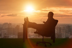 The businessman relaxing in the office Royalty Free Stock Photos