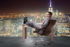 The businessman relaxing in the office Stock Images