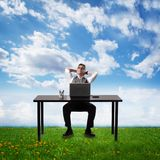 Businessman relaxing in the office. Stock Photos