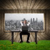 Businessman relaxing in the office. Royalty Free Stock Photo