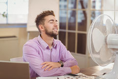 Businessman relaxing in office Stock Photos