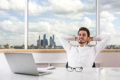 Businessman relaxing in office Royalty Free Stock Photos