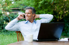 Businessman relaxing outdoor Royalty Free Stock Photography