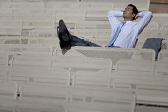 Businessman relaxing outdoors Royalty Free Stock Images