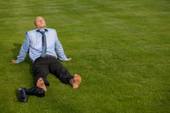 Businessman relaxing in park Royalty Free Stock Photos