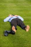 Businessman relaxing in park Stock Image