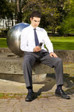 Businessman relaxing in park during lunch break Royalty Free Stock Photography