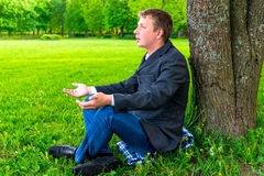 Businessman relaxing in the park Royalty Free Stock Images