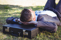 Businessman relaxing in the park Stock Photography