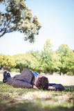 Businessman relaxing in the park Stock Photo