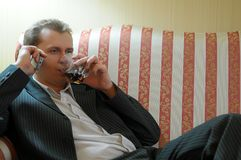 Businessman relaxing on sofa Stock Photos