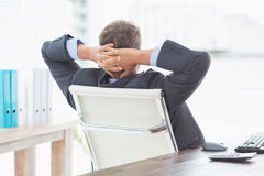 Businessman relaxing in a swivel chair leaning back Royalty Free Stock Photo