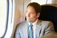 Businessman Relaxing On Train Journey Stock Photos