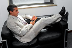 Businessman relaxing with your smartphone Royalty Free Stock Photo
