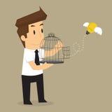 Businessman release idea bulb Stock Photography