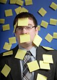 Businessman with reminder notes. Businessman overwhelmed with yellow sticky reminder notes Royalty Free Stock Photography