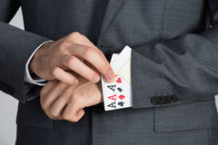 Businessman Removing Ace Cards From Sleeve Stock Photography