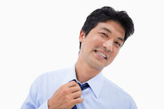 Businessman removing his tie Royalty Free Stock Photos