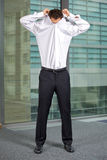 Businessman removing shirt at office Royalty Free Stock Image