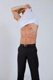 Businessman removing shirt at office Stock Photos