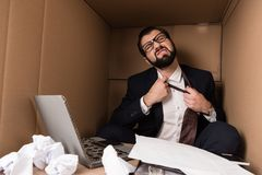 Businessman removing tie stock images