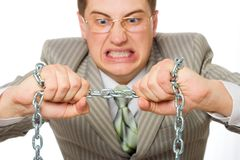 Businessman rending the chain. Businessman in rage, trying to rend the chain, white background Stock Photography
