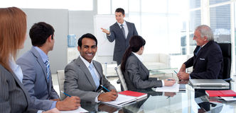 Businessman reporting sales figures to his team Royalty Free Stock Photo