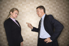 Businessman Reprimanding Businesswoman Stock Images