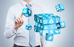 Businessman resolving cube puzzle Royalty Free Stock Photography