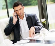 Businessman in a restaurant Royalty Free Stock Photo
