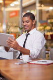Businessman in the restaurant,  working on digital tablet Stock Photo