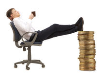 Businessman resting in armchair Stock Images