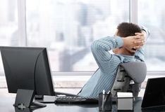 Businessman resting at desk Stock Image