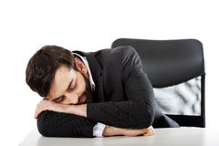 Businessman resting at the desk. Stock Photos
