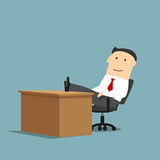 Businessman resting with feet on the table. Relaxed smiling cartoon businessman is resting at workplace with feet on the table. Coffee break, relaxation themes Stock Photo