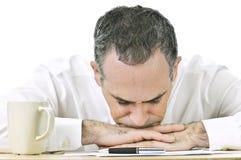 Businessman resting head on hands Stock Photos