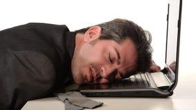 Businessman resting head on laptop stock video