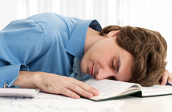 Businessman resting head on notebook Royalty Free Stock Photos