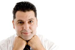 Businessman resting his chin on his fists Stock Photo